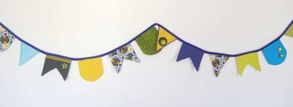 Bandeirinhas de tecido são fáceis de fazer e deixam a sua festa com visual diferenciado (Foto: minhasinger.com.br)