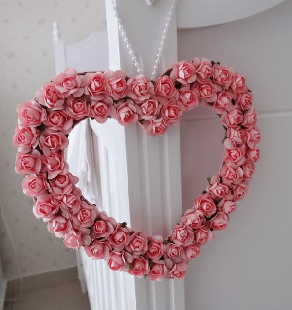 coração de flores rosas