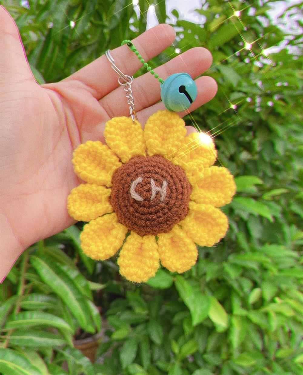 flor de girassol com inicial do nome