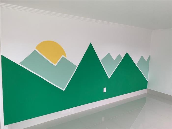 parede pintada com fita verde